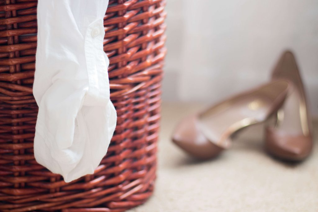 laundry basket with shoes near mom fail