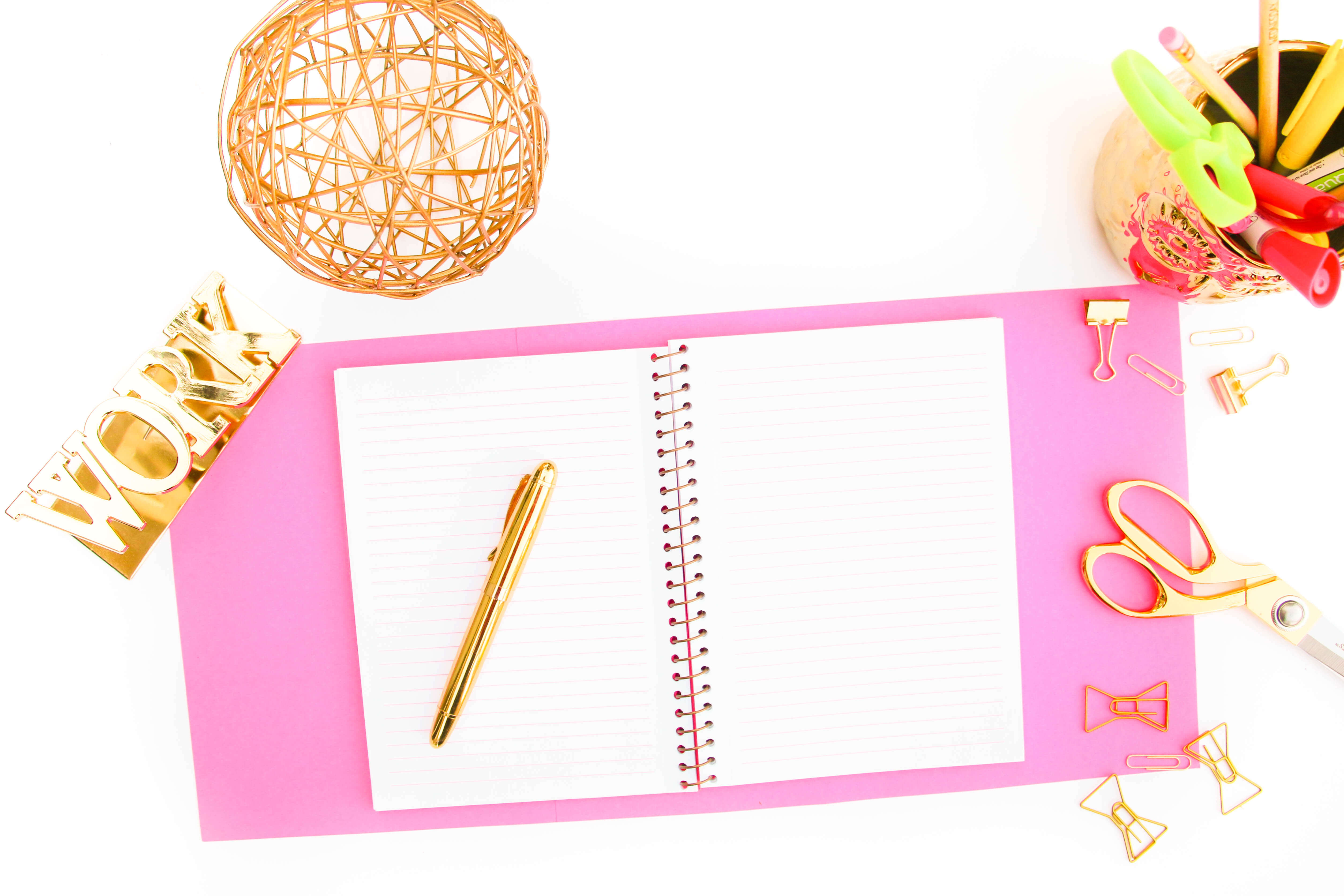 flatlay photo with notebook and pen and gold ball,dreams to reality