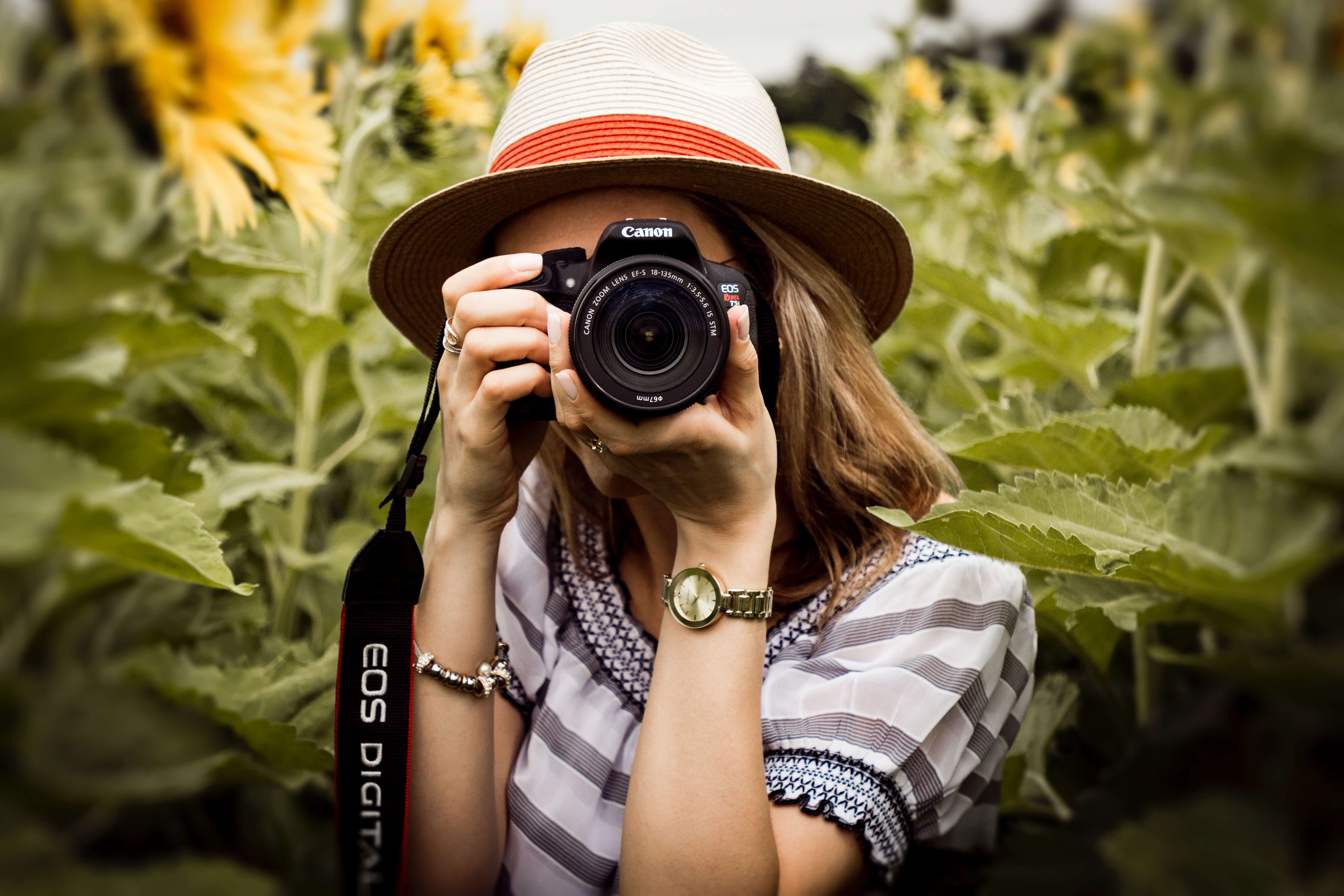 woman taking picutres, actitivities for last days of summer